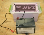 Battery & Plastic container with foam board insulation.